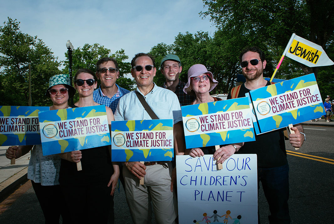 Robert Bank, center, President of the American Jewish World Service, stands with a group from the organization. The group was part of a coalition of many faith groups that all marched in solidarity together during the march.