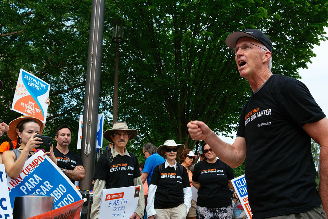 Trip Van Noppen, president of Earthjustice, speaks to a group of supporters at the Peoples Climate March.<