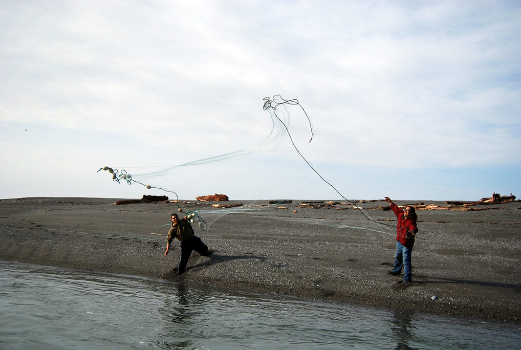 Yurok fishers Pete Thompson (left) and Bob Ray set a net in the Klamath River estuary.