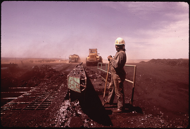 May, 1972: A Navajo workman covers his face at the Peabody Coal Company in Black Mesa, Arizona.