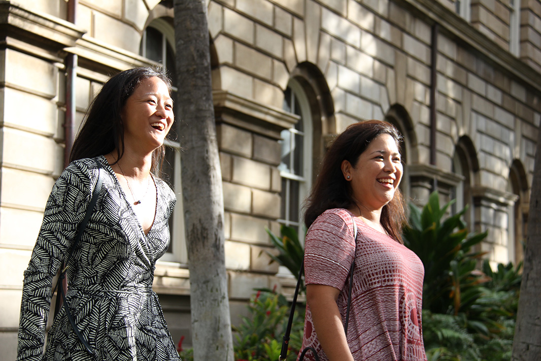 Associate Attorneys Kylie Wager (left) and Summer Kupau-Odo walk past the Hawai'i Supreme Court.