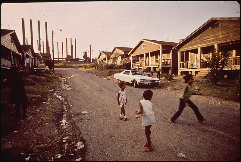 July, 1972: Children play in housing right next to the U.S. Steel plant in Birmingham, Alabama.