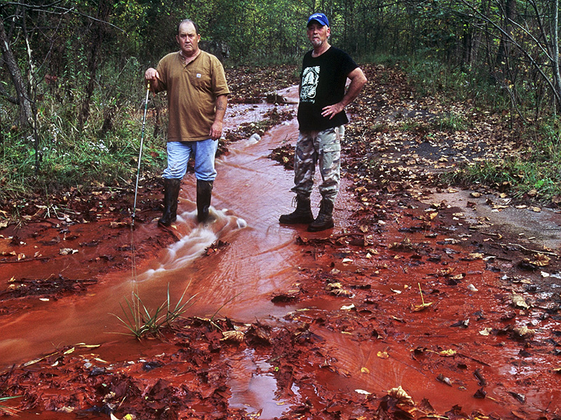 The same pollution as the previous image. Owen Stout (left), a resident of Daws, West Virginia (farther down Cabin Creek), stands with anti-coal activist Chuck Nelson.