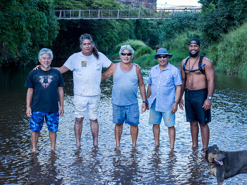 Pō'ai Wai Ola members standing in lower reach of Waimea River.