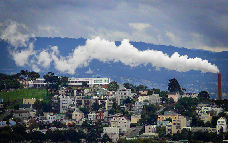 A steam plume blows over Noe Valley neighborhood in San Francisco.
