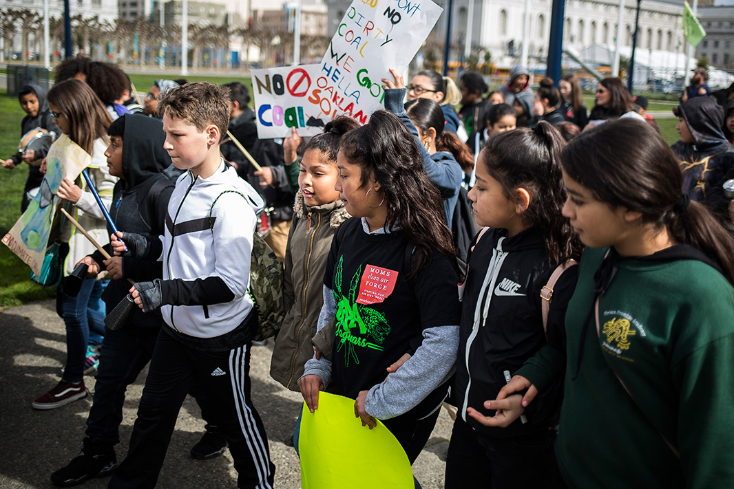 Students from the Urban Promise Academy public middle school in Oakland marched to this chant on their way to San Francisco City Hall, where the EPA held its listening session. Bay Area residents, alongside Earthjustice, have been fighting a coal export terminal at the Port of Oakland.
