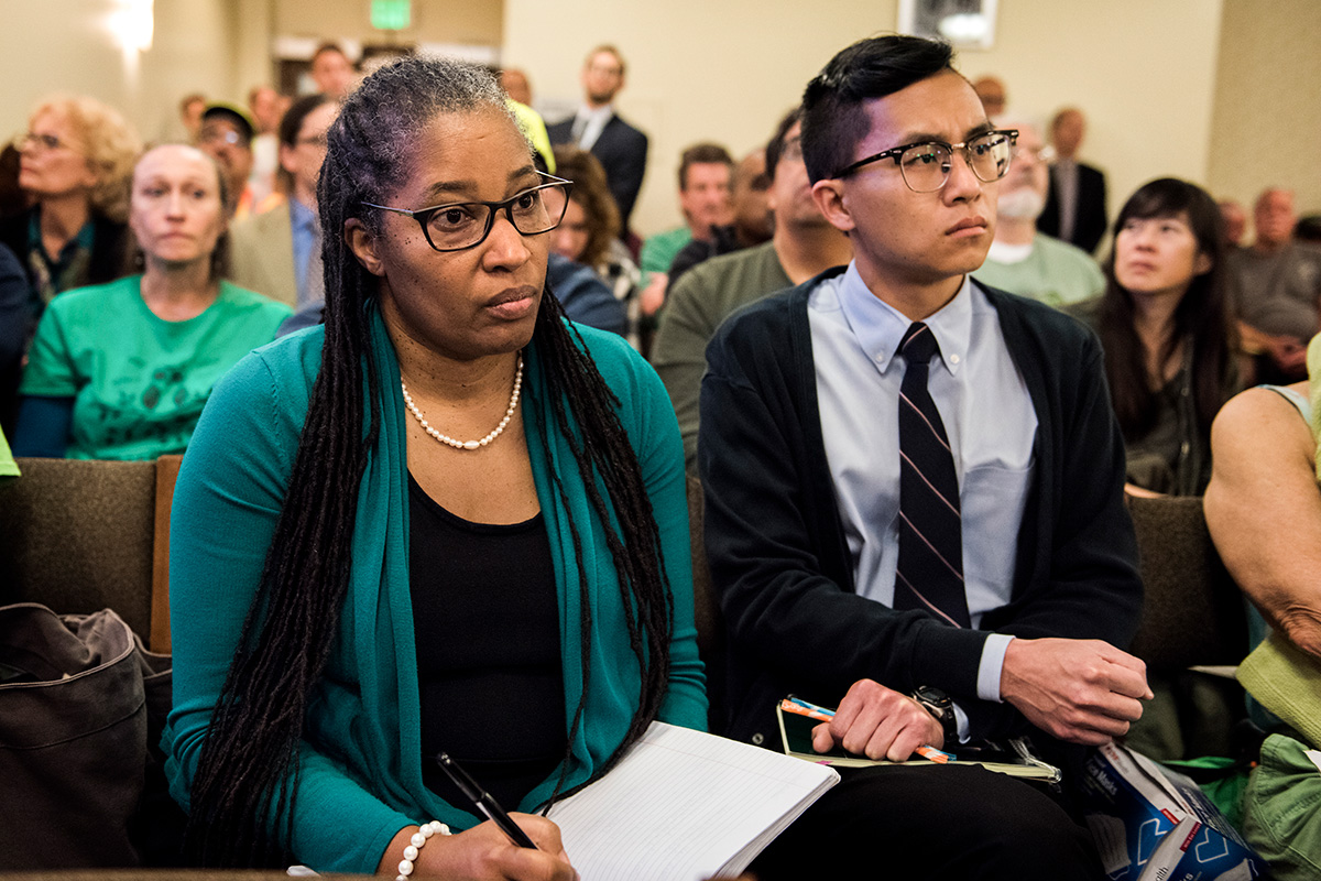 Earthjustice attorneys Angela Johnson Meszaros and Byron Chan at one of several hearings held on the proposed Grayson gas plant in Glendale, Calif. These packed hearings often went on into the late hours of the night.