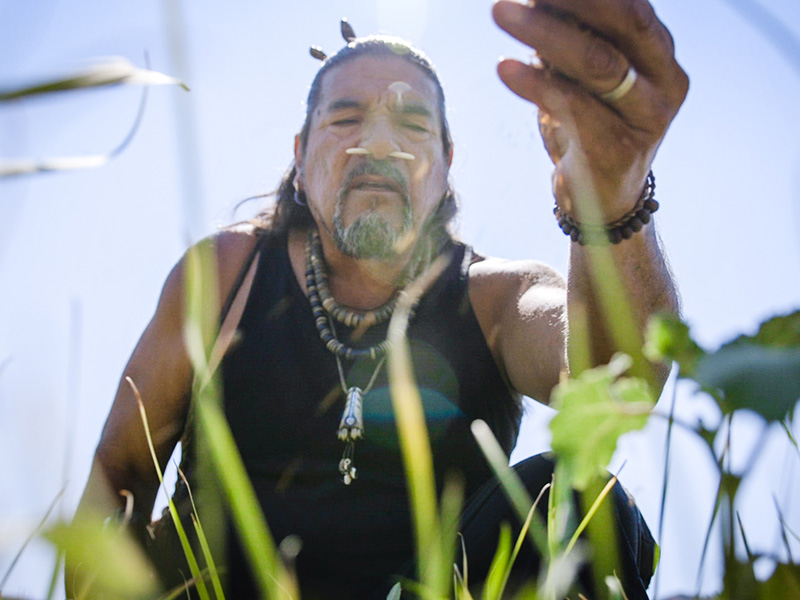 Mati Waiya, a Chumash ceremonial elder, founder and executive director of the Wishtoyo Foundation offers tobacco at the end of the ceremony in opposition of the proposed Mission rock power plant.