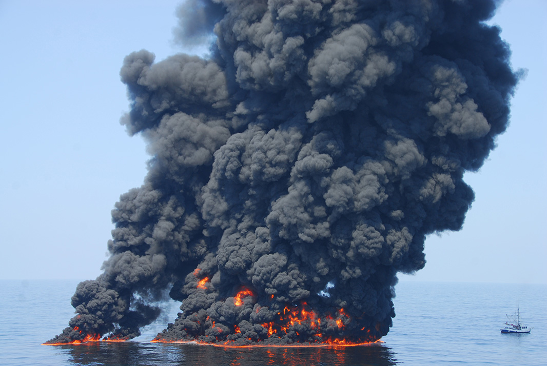 An in situ burn of oil from the Deepwater Horizon disaster sends towers of fire hundreds of feet into the air over the Gulf of Mexico on June 9, 2010.