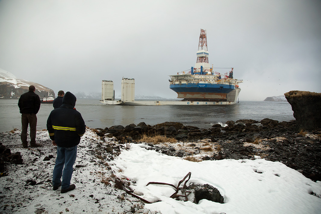 The drillship Kulluk is towed out of Alaska on March 26, 2013, after the towing line to the icebreaking anchor-handling tug Aiviq parted in heavy weather, and the unit ran aground on Sitkalidak Island.