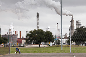 Millions of Americans live close enough to a facility that uses or stores dangerous chemicals to be potentially affected by a chemical disaster. Then 3-years-old, Chrisangel rides his tricycle in Hartman Park, in Houston, Tex. near the Valero refinery. (Eric Kayne for Earthjustice)