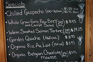 A restaurant menu displays calorie information next to menu items. (IDEOWL / CC BY 2.0)
