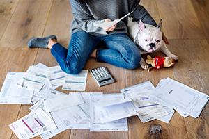 Paying the bills. (Raw Pixel / Getty Images)