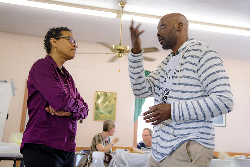 Earthjustice attorney Adrienne Bloch speaks with a community member at a RISE St. James meeting.