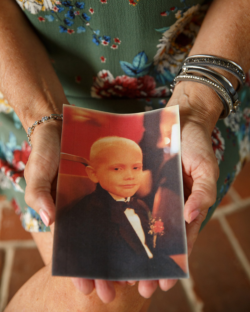 Former Warminster resident Joanne Stanton holds a picture of her son, who survived cancer that may have been linked to PFAS exposure.
