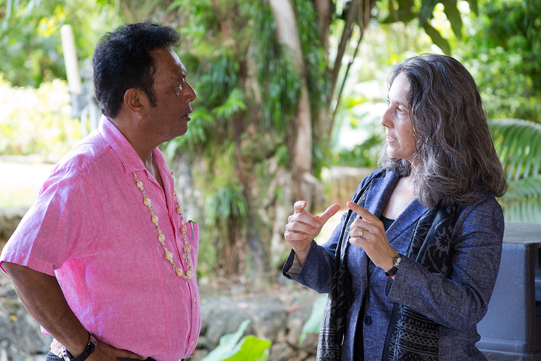 Staff Attorney Erika Rosenthal and President of Palau Tommy E. Remengesau, Jr. at the Palau Renewable Energy Summit at the Ngarachamayong Cultural Center on Palau.