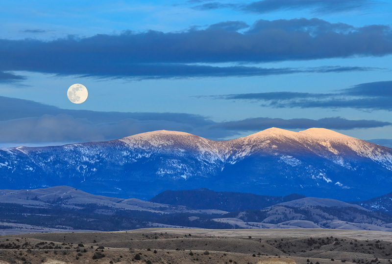 A full moon above Mount Baldy in the Big Belt Mountains near Townsend, Mont. Nearby land was recently protected by a federal judge's ruling.