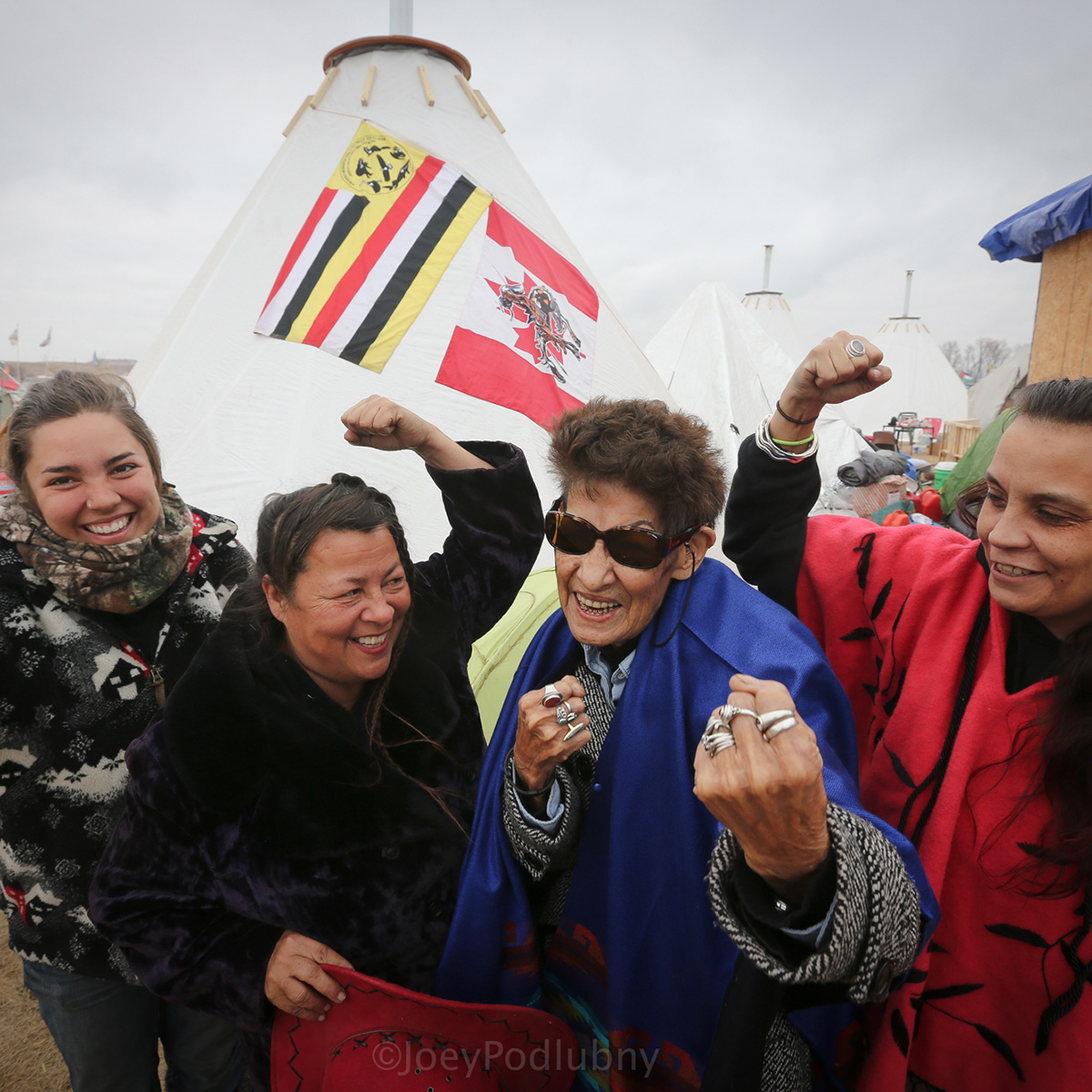 At the Oceti Sakowin Camp in 2016, Taylor Peterson, Katherine Morrisseau, Nancy Scanie, and Fawn Youngbear-Tibbetts (left to right). Clan Grandmother Nancy Scanie from Cold Lake Dene First Nation in Alberta Canada represented the Athabasca Keepers of the Water.