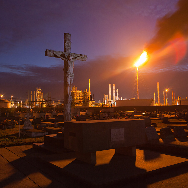 A cemetery stands in stark contrast to the chemical plants that surround it in Louisiana's 'Cancer Alley.'