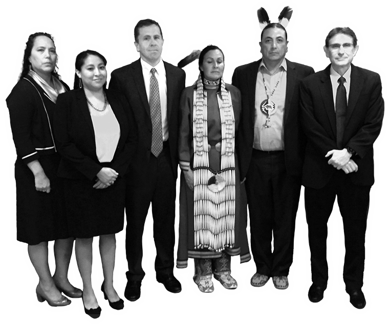 A black and white image of Earthjustice attorneys and the Standing Rock Sioux Tribe -- they dressed in suits and traditional garments.