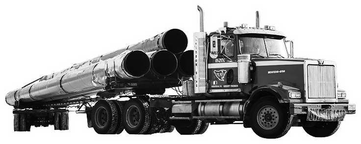 A black and white image of a semi truck carrying pipes.