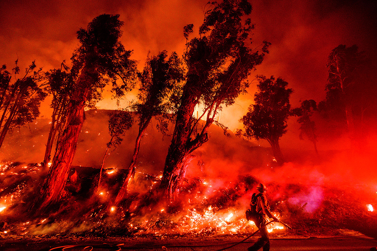 Flames from a backfire consume a hillside as firefighters battle the Maria Fire in Santa Paula, Calif., on Nov. 1, 2019.