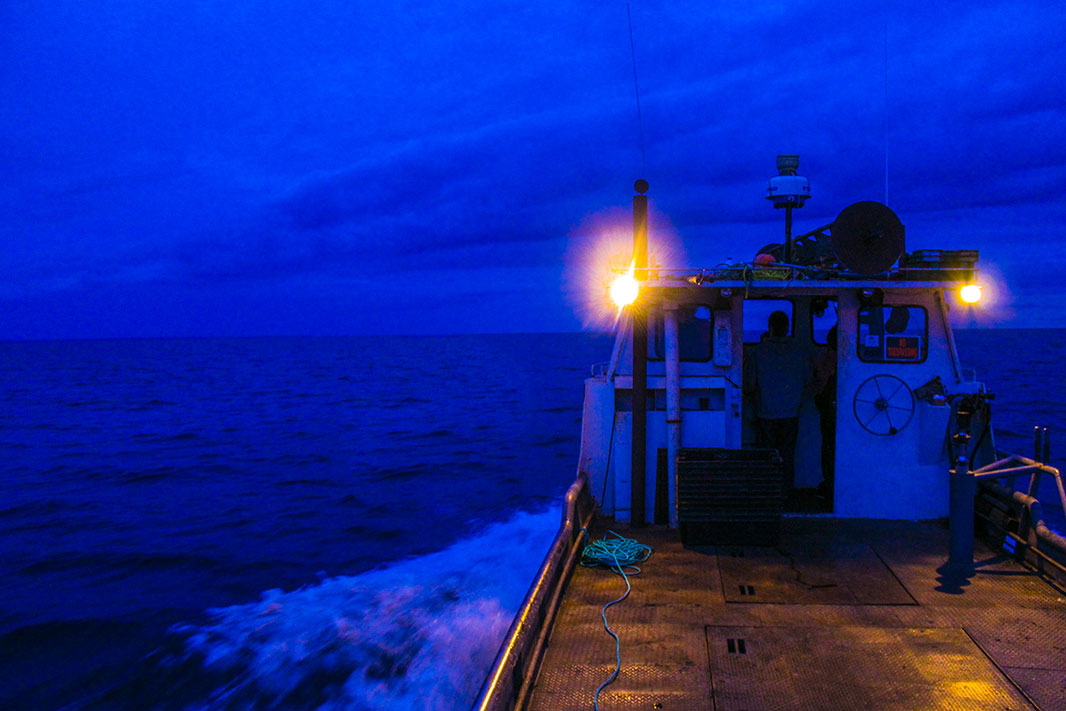 The Little Mealie, a tribal fishing tug boat going out on Lake Superior before dawn.