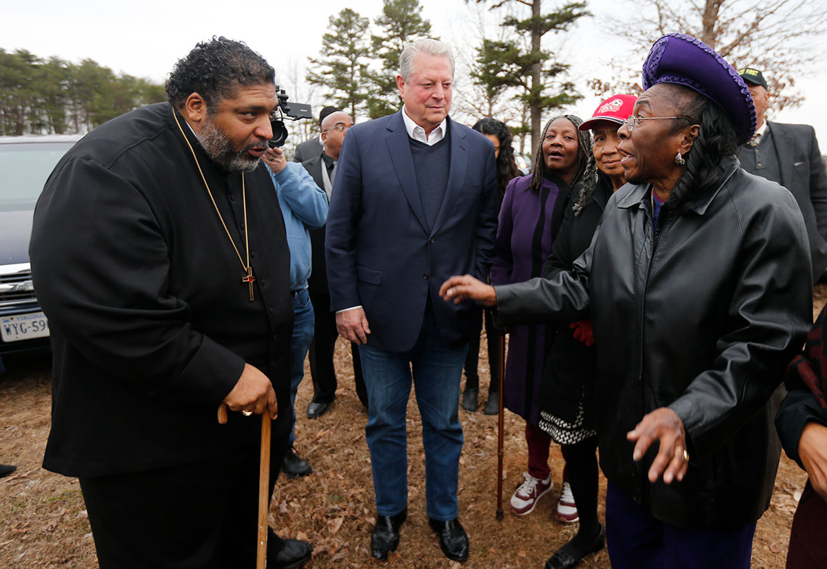 Rev. William Barber, left, and former Vice President Al Gore, center, speak with local resident Ella Rose in front of her home in Union Hill, Va., Feb. 19, 2019. Mrs. Rose's home was adjacent to a proposed compressor station site for the Atlantic Coast Pipeline.
