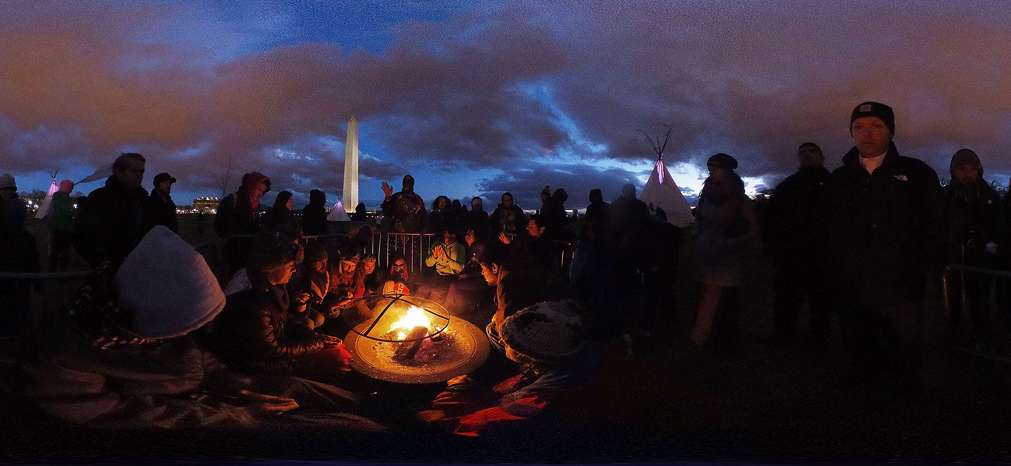 Activists gather around a sacred fire at the ground of Washington Monument after a day of protest on Mar. 10, 2017, in Washington, D.C. The Standing Rock Sioux Tribe staged protests outside the Army Corps of Engineers Office, the Trump International Hotel, and a march to the White House to urge for halting the construction of the Dakota Access Pipeline.