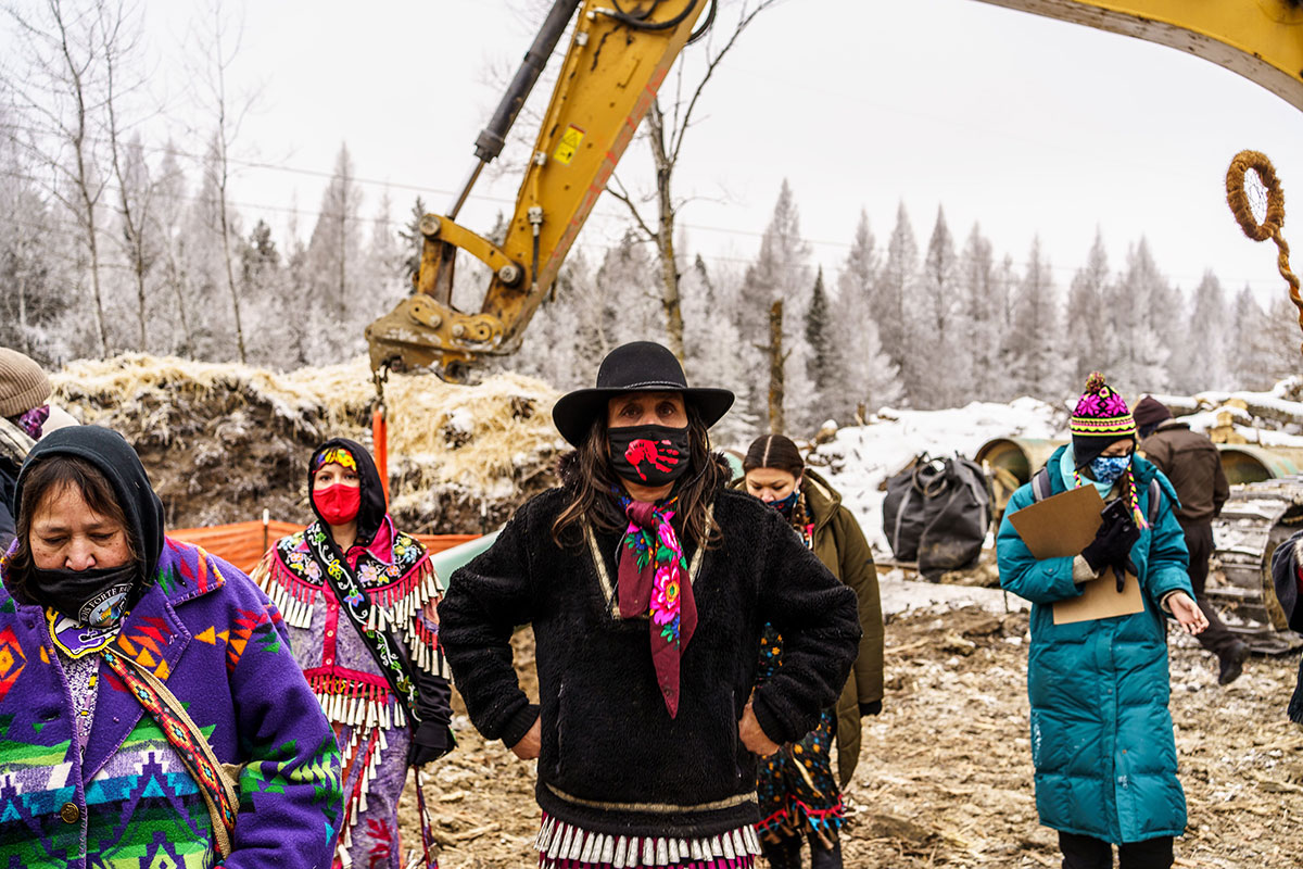 Environmental activist Winona LaDuke, center, and water protectors stand in front of the construction site for the Line 3 oil pipeline near Palisade, Minn., on Jan. 9, 2021.