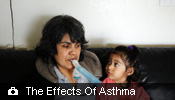 Ana Corona takes medication for her asthma while her daughter watches.