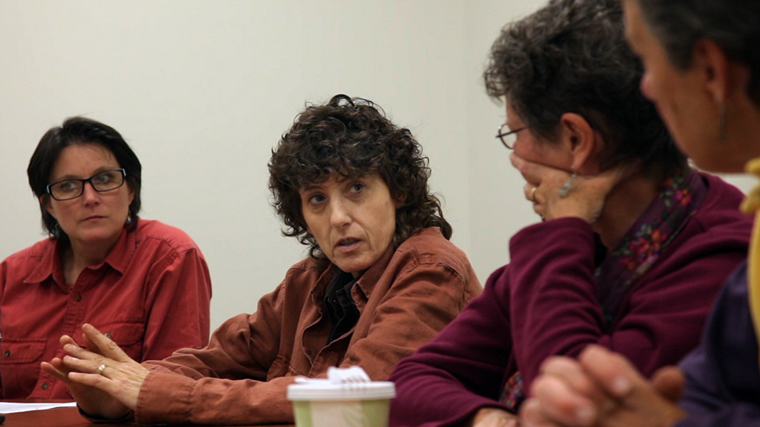 Marie McRae listens to Joanne Cipolla Dennis at a Dryden Resources Awareness Coalition (DRAC) meeting.
