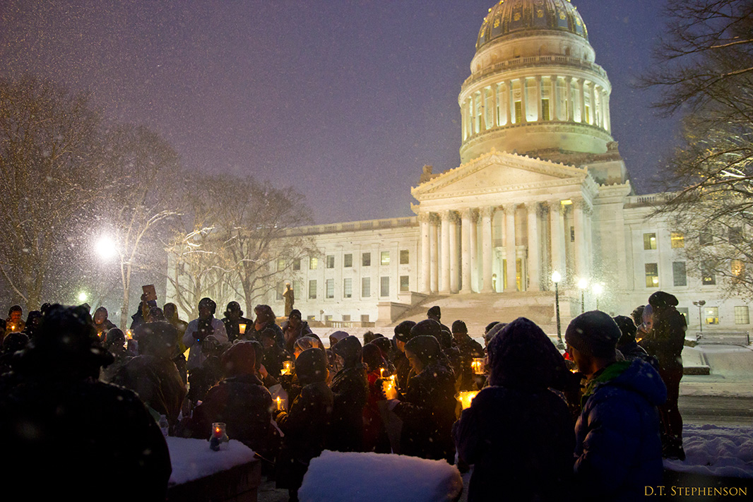The candlelight vigil outside of the Capitol.