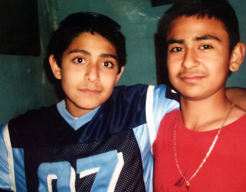 A 12-year-old Tellez (left) and his cousin, a year after he began working in the fields.