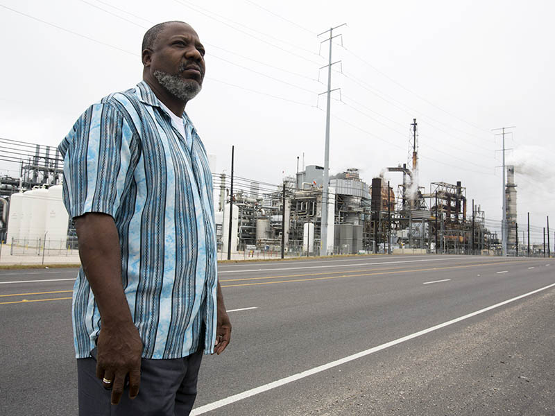 Activist Hilton Kelley stands before the Valero refinery in Port Arthur, Texas.