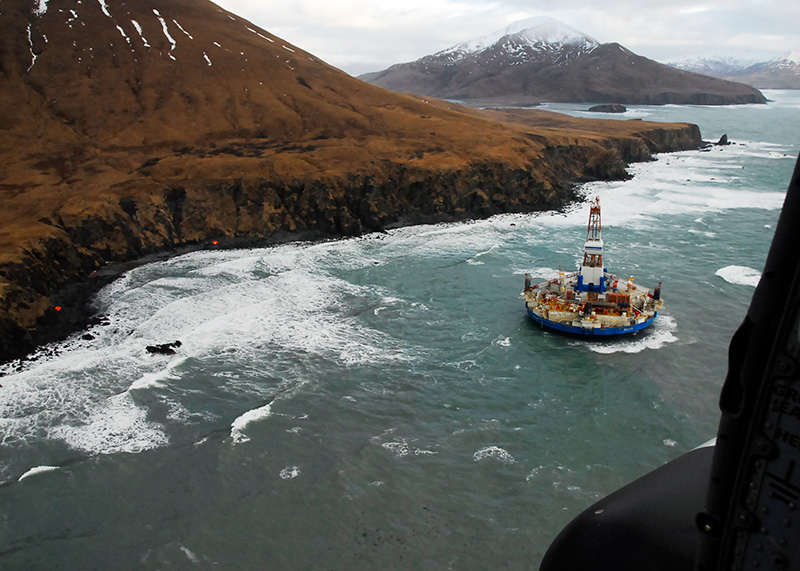 Shell Oil's drilling unit Kulluk sits grounded off an uninhabited Alaskan island in 2012.