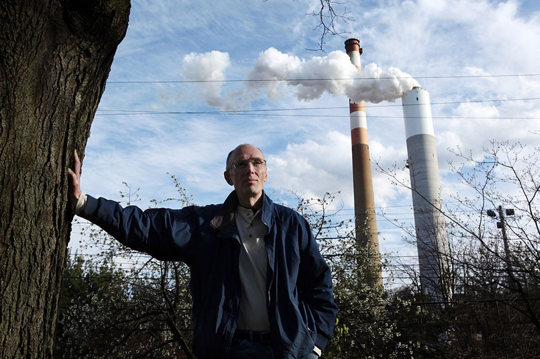 Martin Garrigan stands near the Cheswick coal plant.