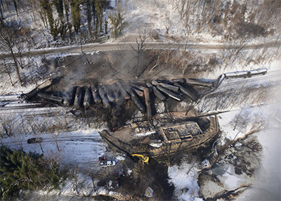 Response crews for the West Virginia train derailment continue to monitor the burning of the derailed rail cars near Mount Carbon next to the Kanawha River, Feb. 18, 2015.