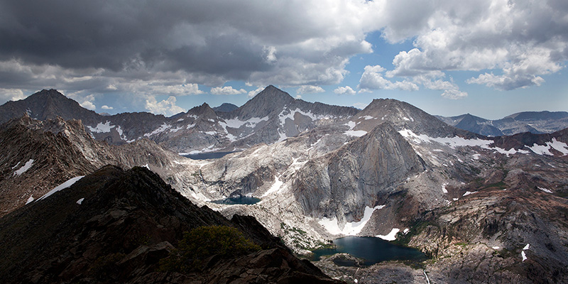 Looking south from Black Rock Pass, Sawtooth Peak (12,343 feet, center) looms over one of the finest sets of stairstep lakes in all the Sierra: Columbine, Cyclamen and Spring Lakes. The upper elevations of the terrain that Disney coveted are visible in the right background.