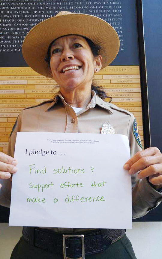 Members of the parks service displayed signs with their future goals.