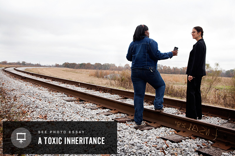 Esther Calhoun (left) speaks with attorney Marianne Engelman Lado at the train tracks that brought the coal ash to Uniontown.