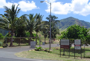 "Entrance to the Mākua Military Reservation. Because the Army had tested only species of limu that Wai'anae Coast families do not eat, its ""conclusion regarding the human health risks presented by limu actually eaten by area residents lacks any meaning. (CZM Hawai'i)"