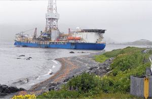 The 571-foot drill rig Noble Discoverer, which is scheduled to drill three exploratory wells in the American Arctic waters of the Chukchi Sea, drifted from its moorings in Dutch Harbor, AK. Locals who witnessed the incident say it ran aground in the harbor. (Photo courtesy of Kristjan Laxfoss)