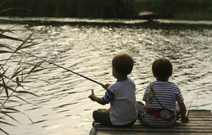 Kids fishing. (iStockphoto)