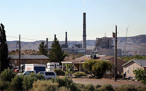 The Reid Gardner Power Plant is seen towering above houses on the Moapa River Reservation home of the Moapa Band of Paiutes. (Chris Jordan-Bloch / Earthjustice)