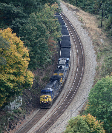 A CSX coal train rounds a curve in West Virginia. Coal destined for export is brought by rail from mining operations in Appalachia to Baltimore's facilities, passing through many communities. (JPMueller99)