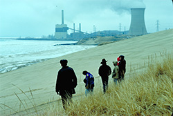 Lake Michigan dunes, with power plant in background. (NPS)