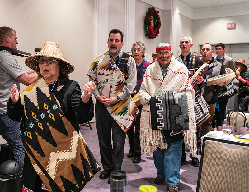 Tulalip Chairwoman Marie Zackuse, Suquamish Chairman Leonard Forsman, Lummi Hereditary Chief Bill James, Swinomish Senator Brian Wilbur, and Swinomish Senator Jeremy James Wilbur lead U.S. Coast Salish tribal members into a hearing before the Canadian National Energy Board in November 2018 in Victoria, British Columbia.