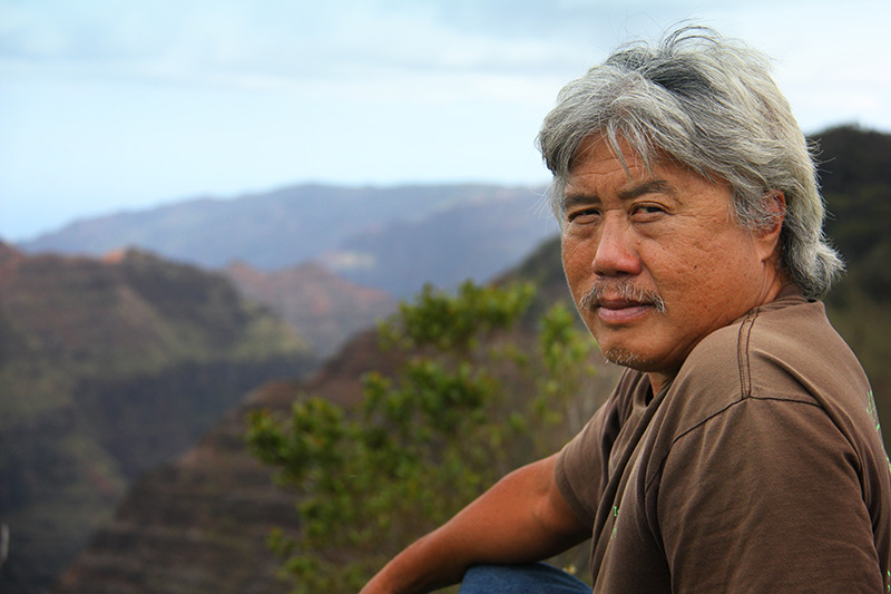 Pō'ai Wai Ola member John A'ana in Waimea Canyon, located on Kauaʻi's West Side above thousands of acres of pesticide spraying operations.