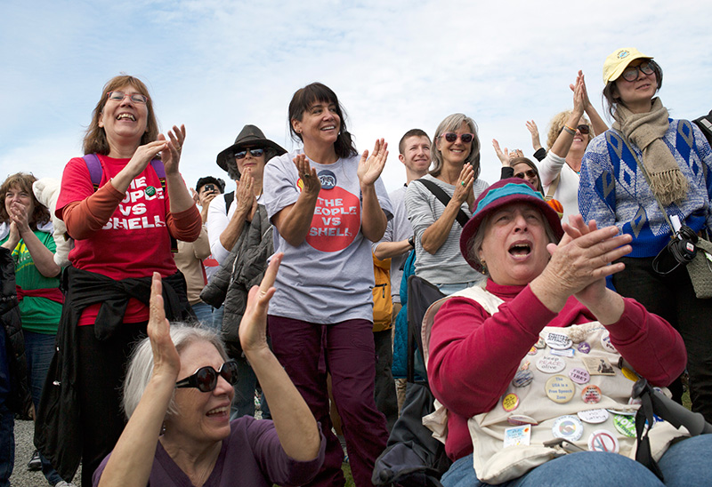 Scenes from the May 18 rally in Seattle against Shell's Arctic drilling fleet. In attendance was a sizeable contingent of the 'Raging Grannies,' who use song and humor to promote global peace, justice, and social and economic equality.